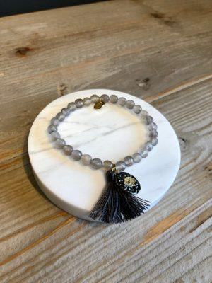 Evil eye tassel beaded bracelet grey